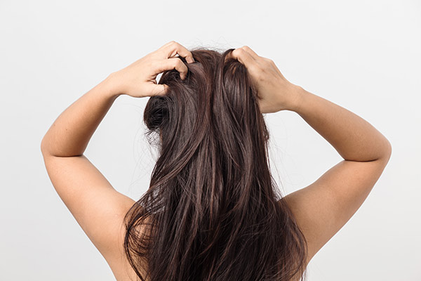 woman running fingers through hair