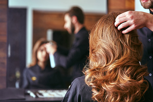 woman getting her hair done at a hair salon