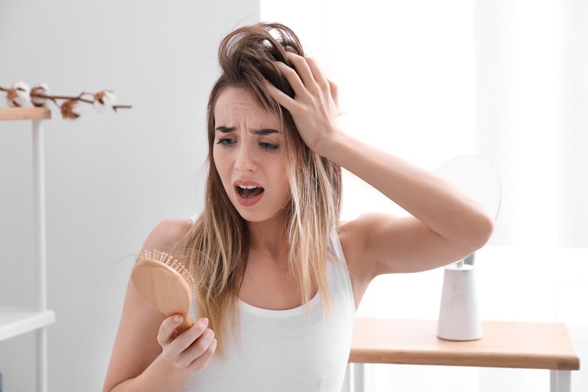 Women reacting to hair on her brush