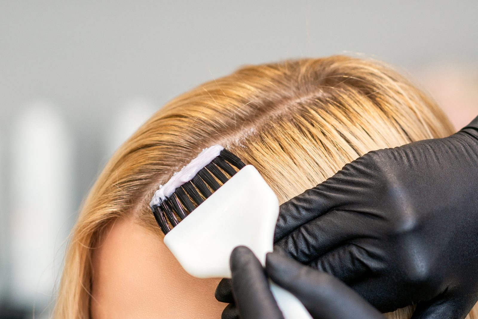 Use Caution When Chemically Processing Your Hair, hair being treated with chemical dye.