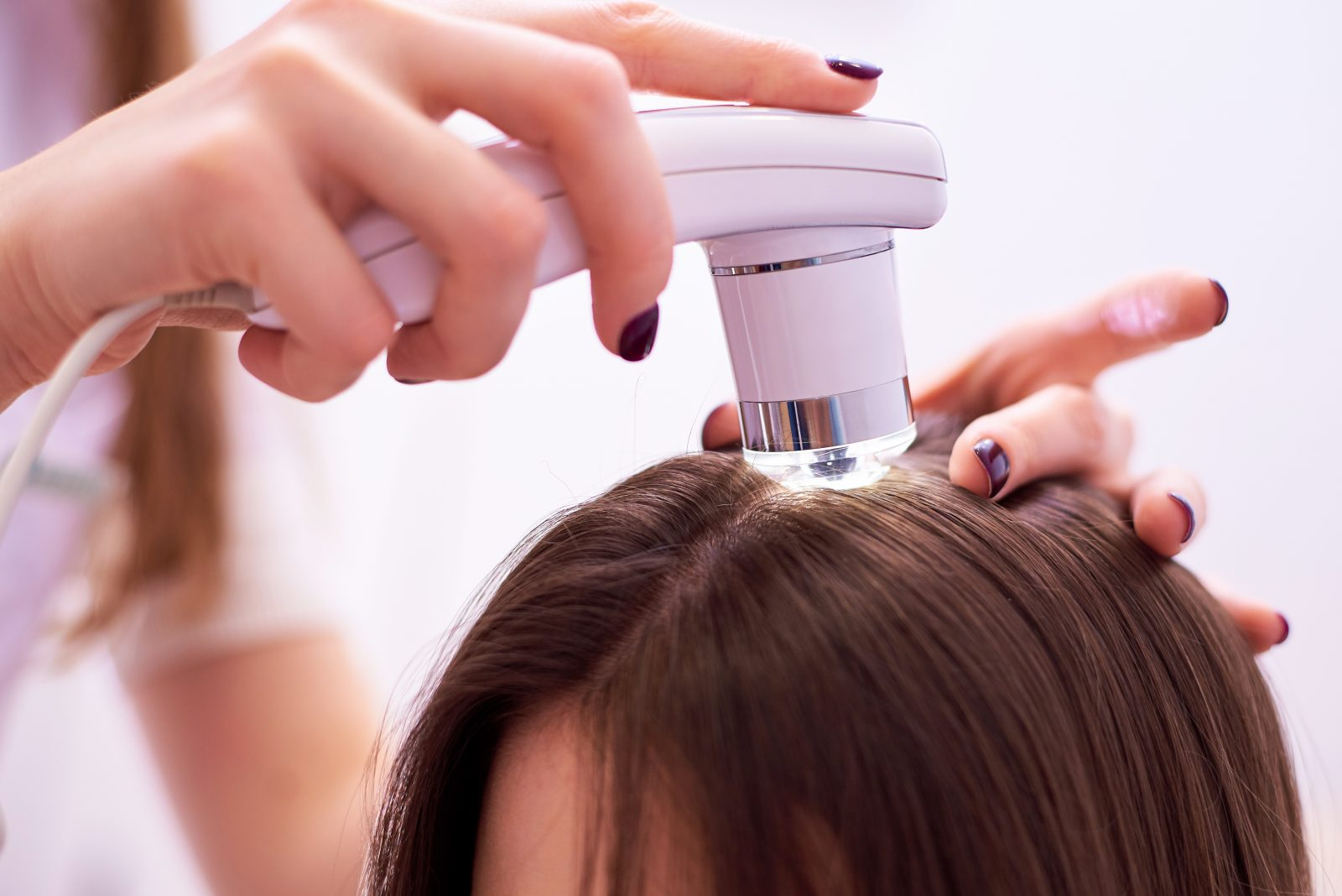 The Use of Medical Treatment,slow level laser light treatment on a patients scalp.