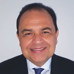 Carlos Gil headshot