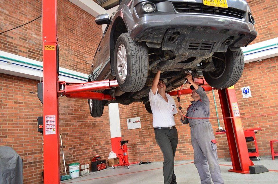 Mechanics working on car