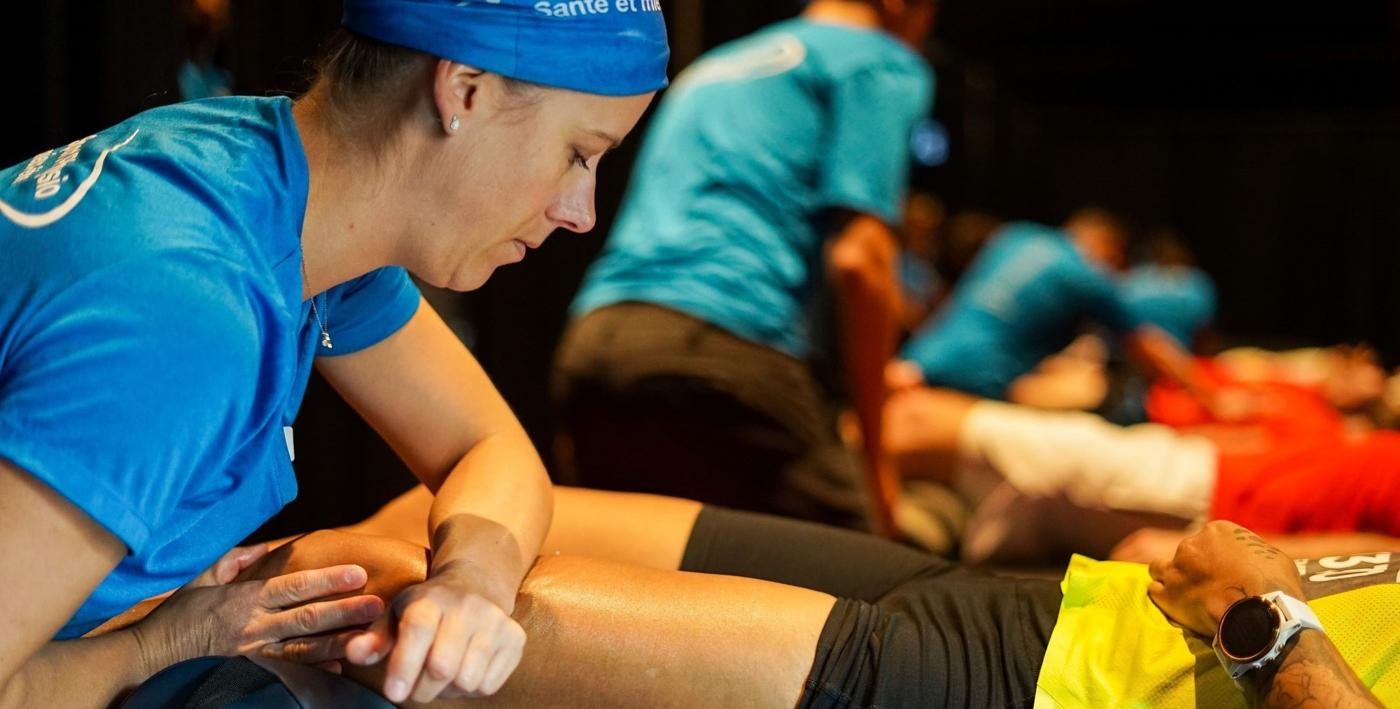 Image of an Action Sport Physiotherapist performaing a physiotherapy session.