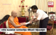 Anura explains 20A to Malwathu Chief Prelate