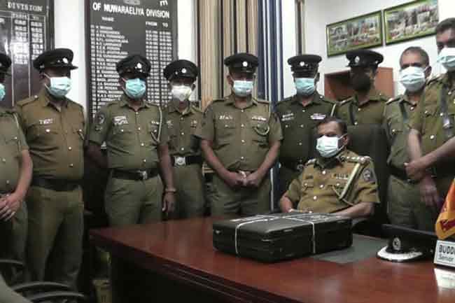 100 கோடி ரூபா பணம் தருவதாக நிதி மோசடி - 9  பேர் கைது
