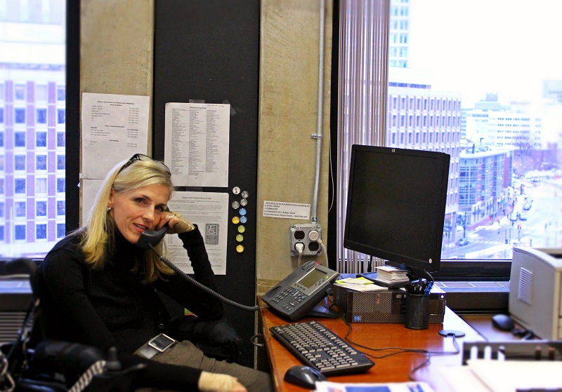 ADA Coordinator in office on the phone.
