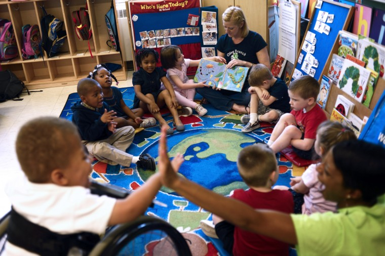 Children in classroom including student in a wheelchair.