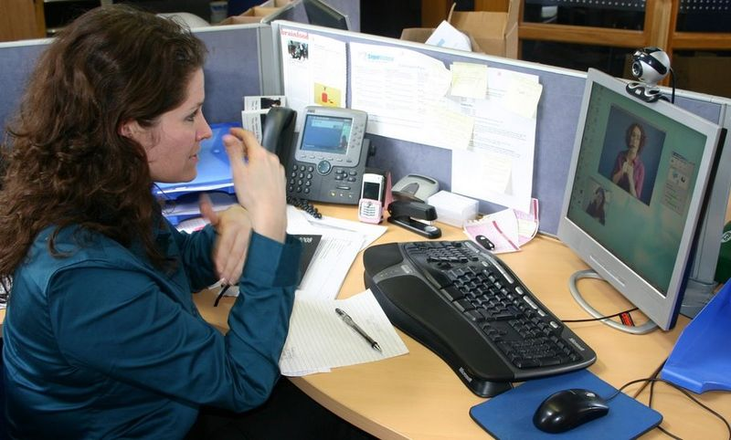 Woman who is deaf signing to video relay communication assistant