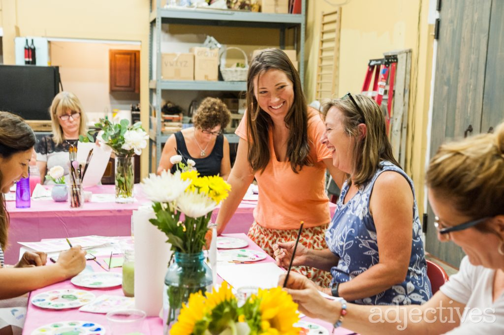 Kara teaching Watercolor class at Adjectives