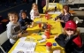 Kids enjoying crafts at Harvest Festival