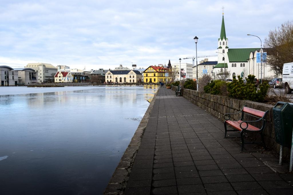 Walking path next to Tjornin lake in Reykjavik