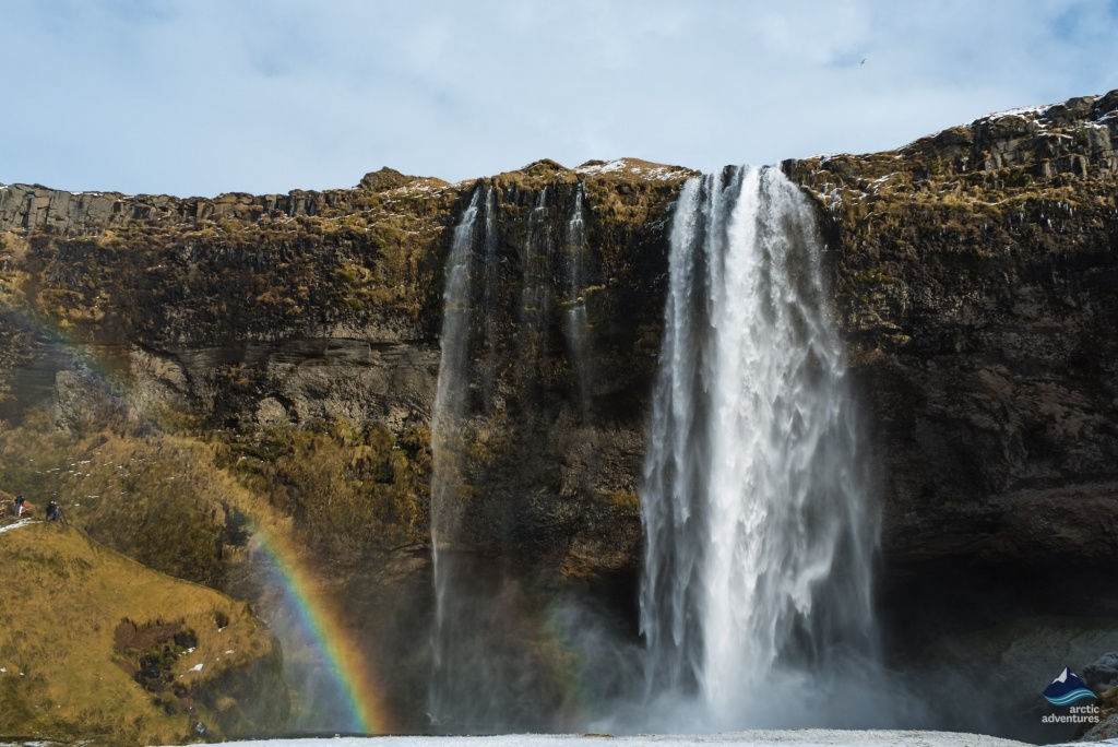Rainbow next to Seljalandsfoss Waterfall in Iceland