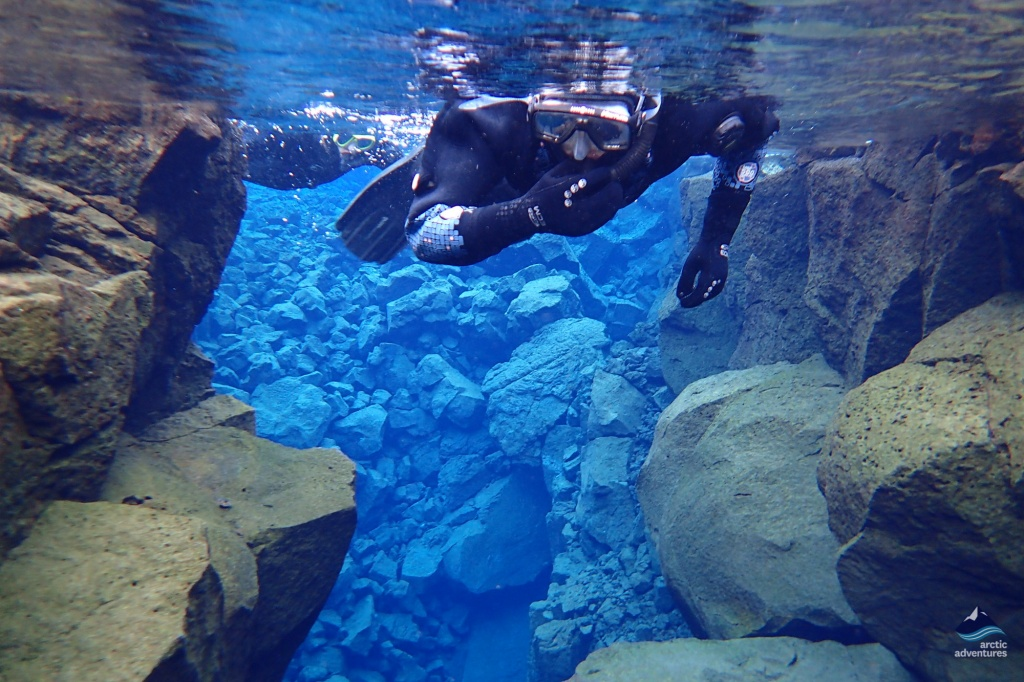 snorkeling at silfra fissure in iceland