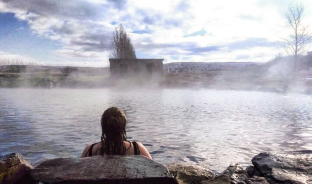 Bathing in Secret Lagoon Hot pool