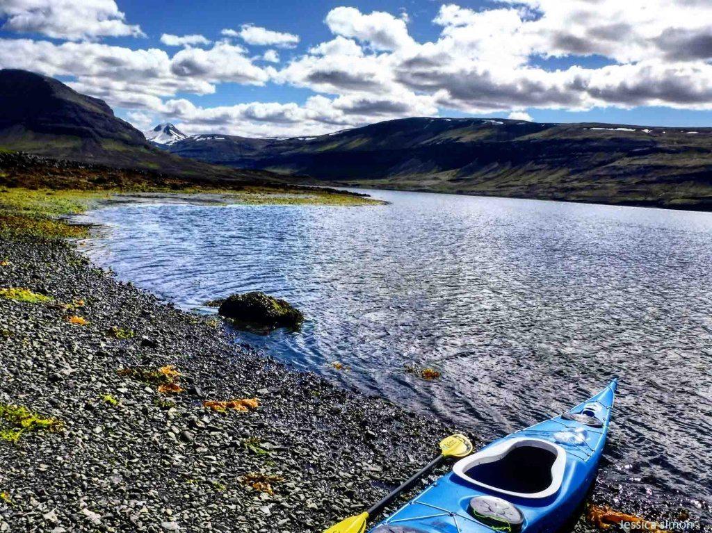 Kayak on shore in Hvalfjordur Iceland