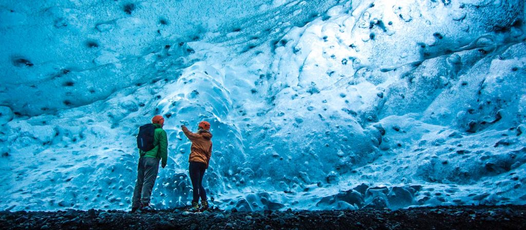 two people in an ice cave in Iceland