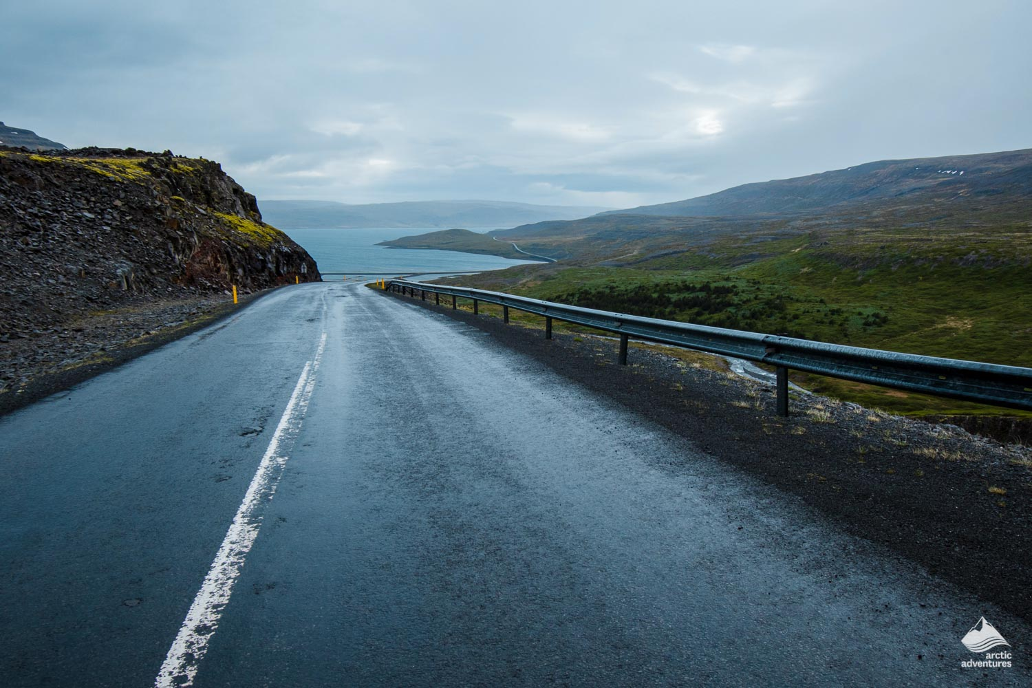 Road in Iceland with a view to a lake