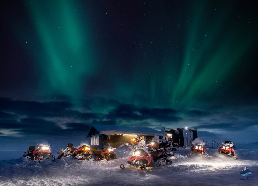 northern lights dancing above the snowmobiling base
