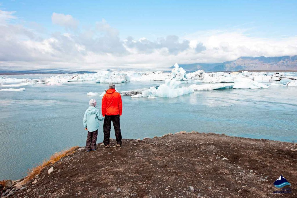Father and son at Jokulsarlon Glacier Lagoon