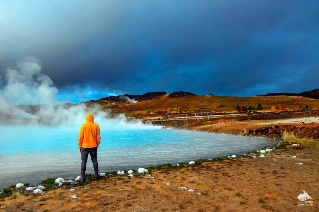 Man standing in the shore of Mývatn volcanic area
