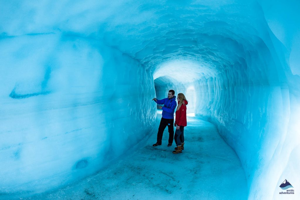 Visitors standing deep inside Langjokull Glacier