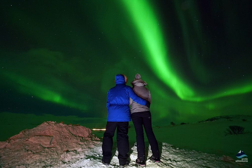 Couple spotting the otherworldly Northern Lights