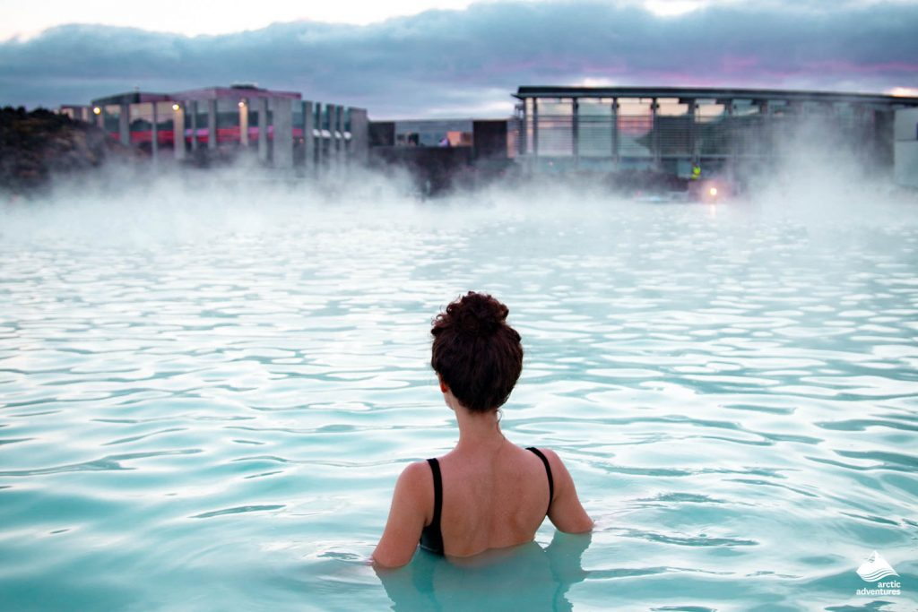 Woman enjoys of spa in hot spring Blue Lagoon