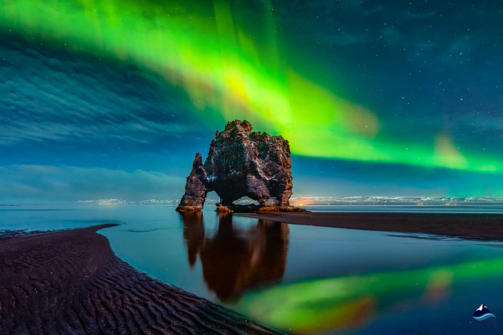 sea stack in northern lights