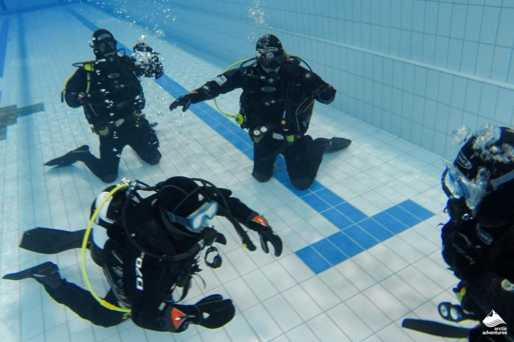 Divers training in Swimming Pool