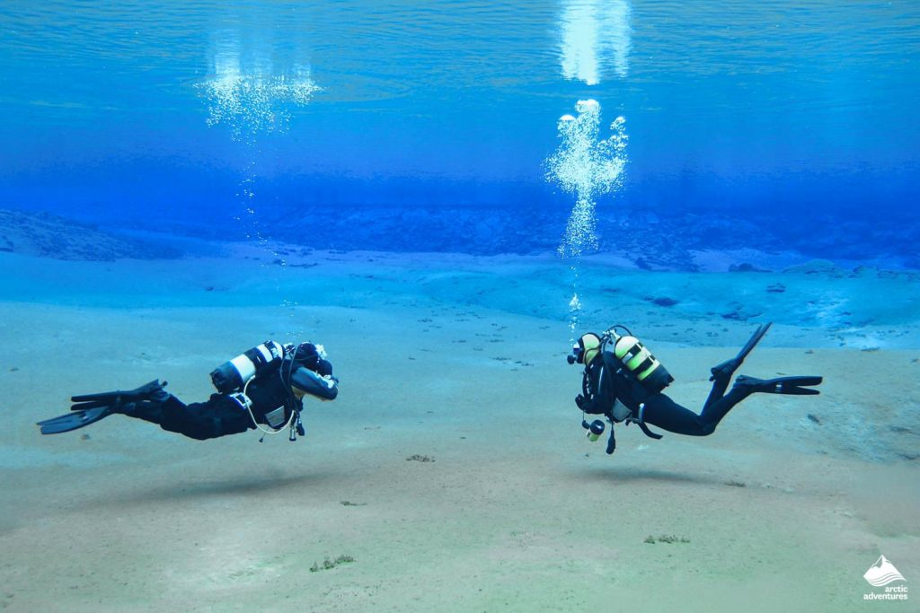 Two divers in Silfra Fissure