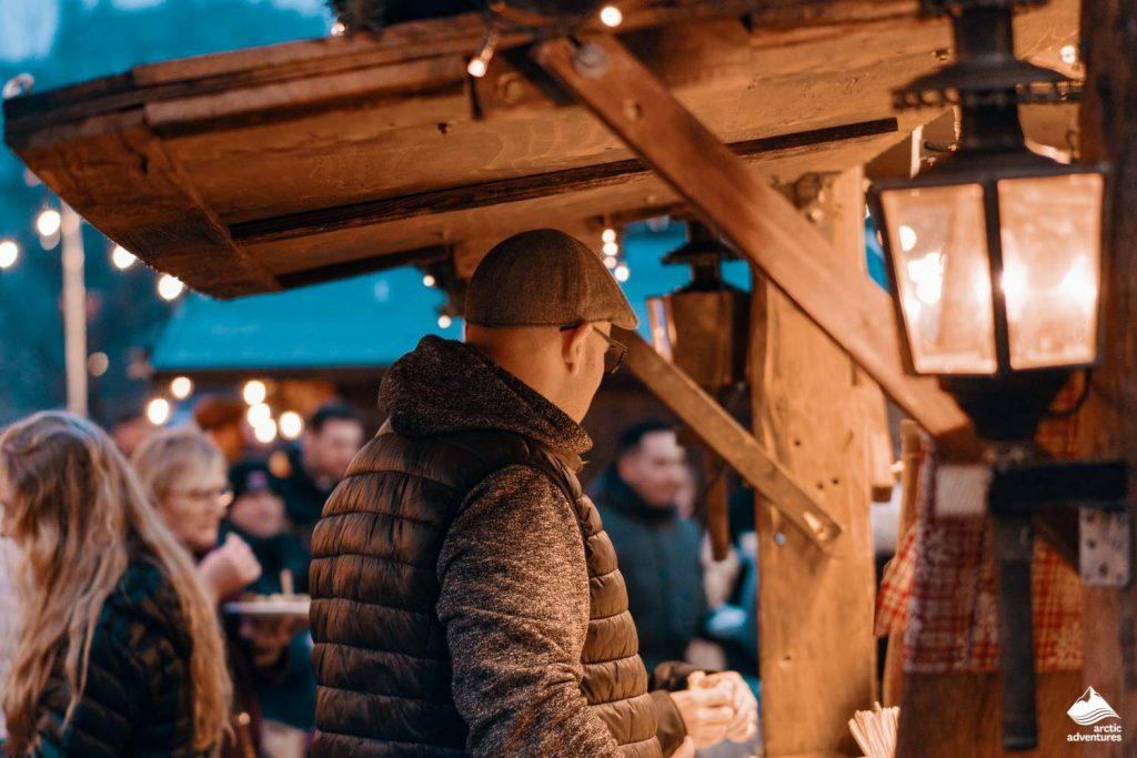 Man in Christmas market in Reykjavik