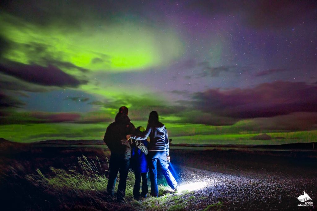 Family admiring at Northern Lights