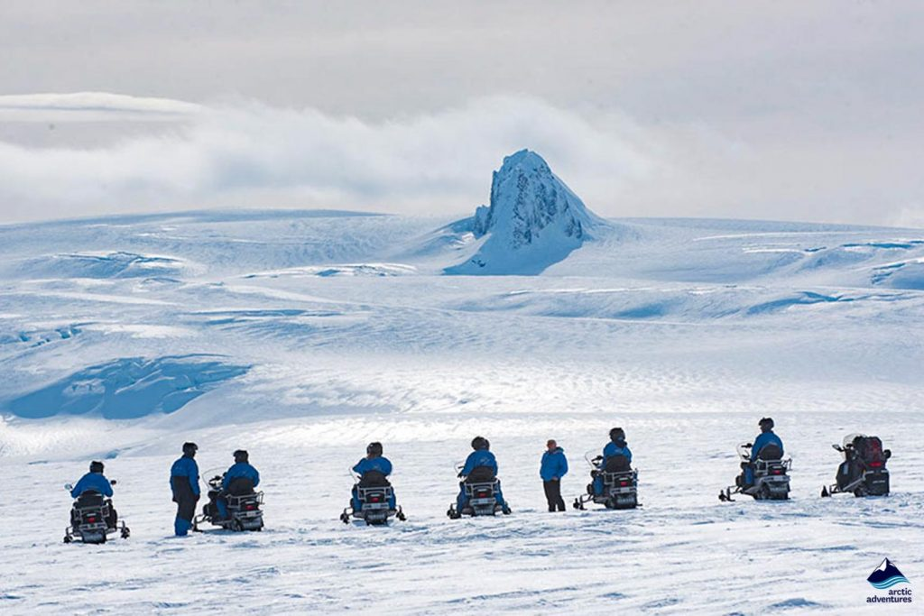 People enjoying view on a snowmobile