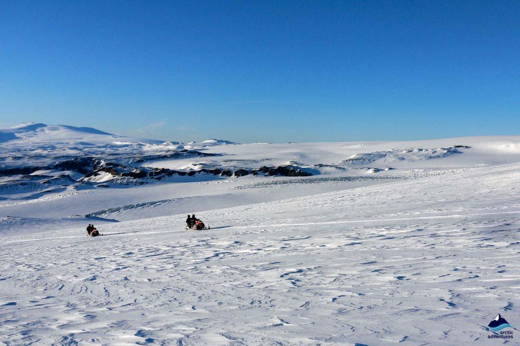 Tourists snowmobiling on Myrdalsjokull glacier