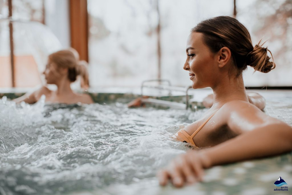 Woman relaxing in whirlpool bath
