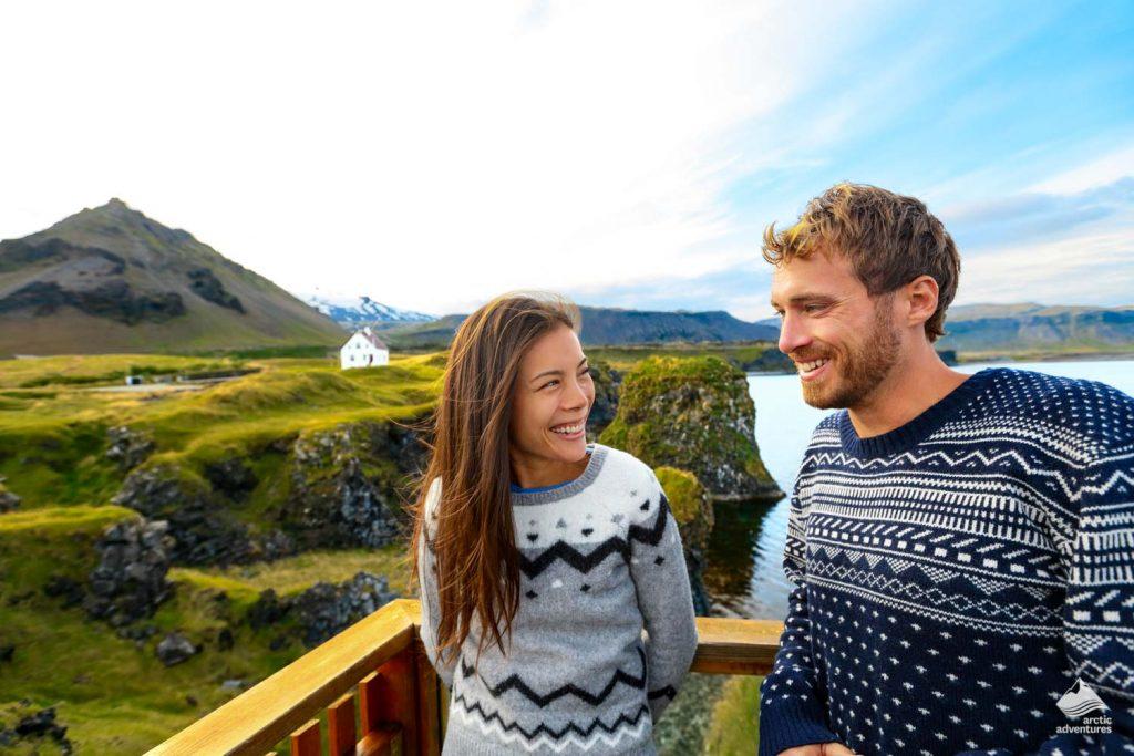 Tourist couple Smiling near Green Mountains