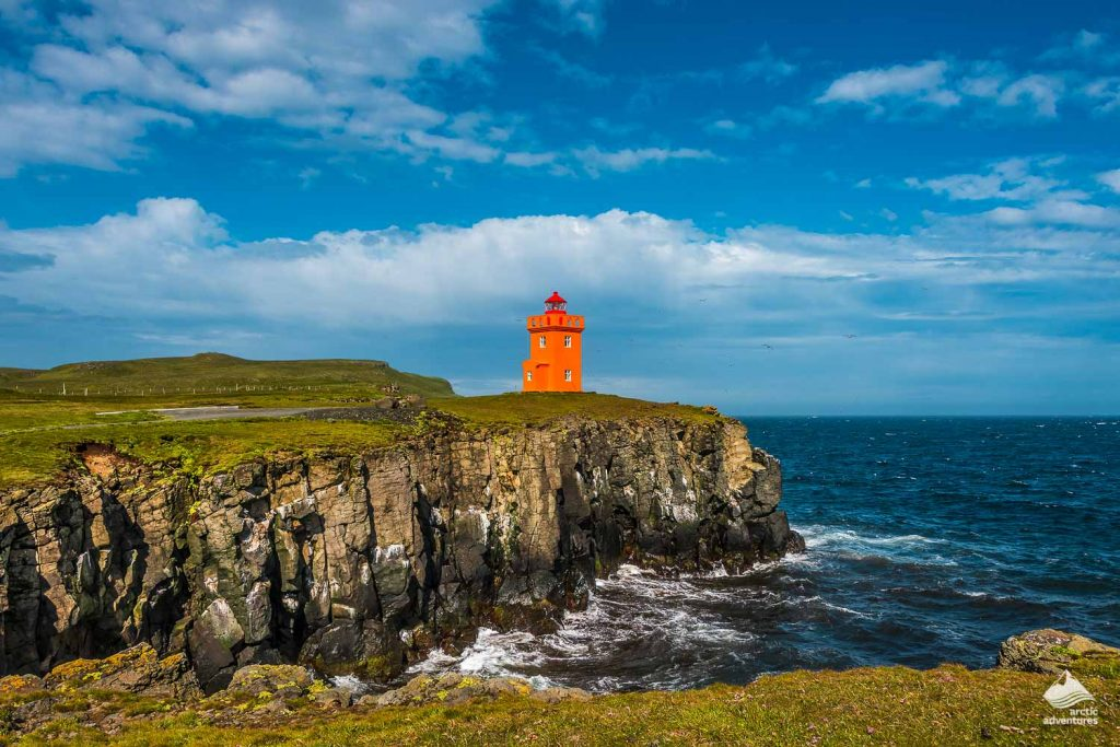 Orange lighthouse at the coast of Grimsey
