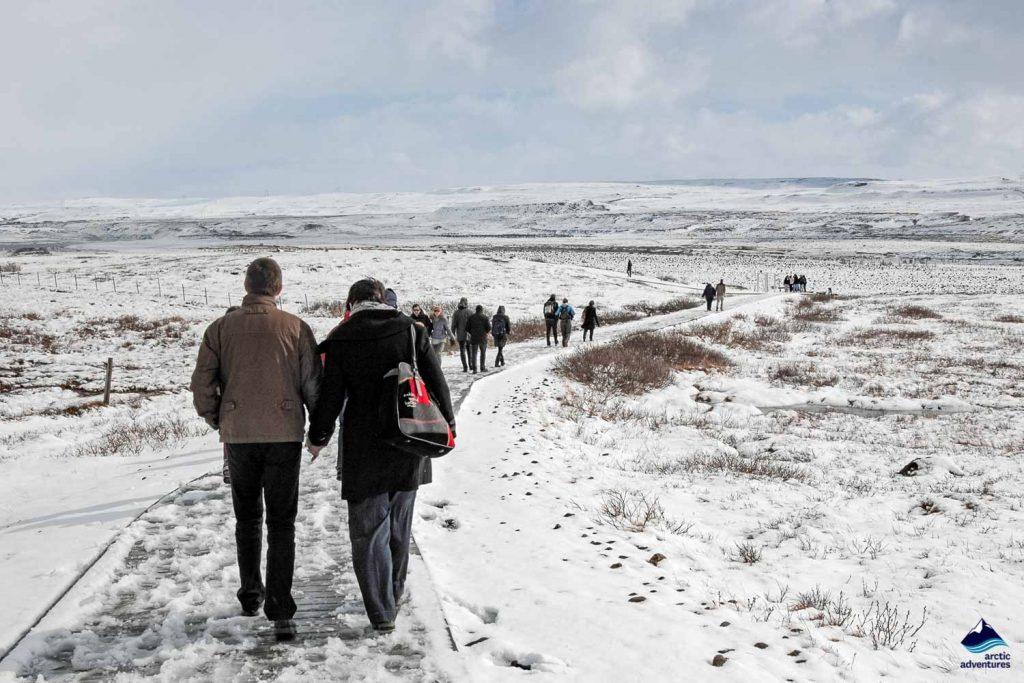 People walking on a patch near Gullfoss in Iceland
