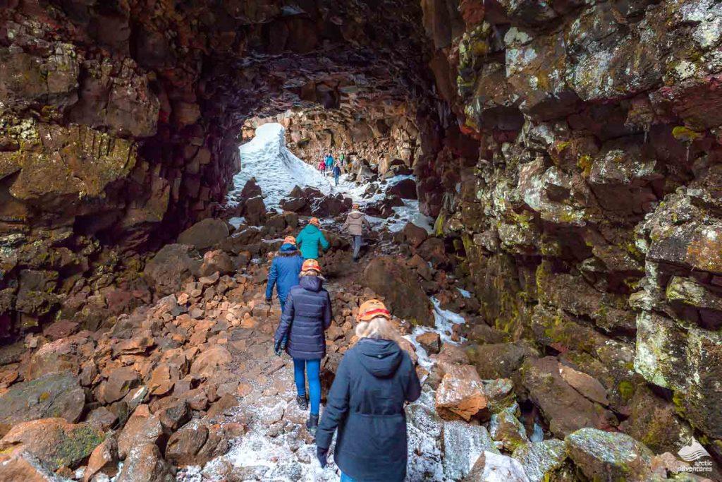 People entering Raufarholshellir lava tunnel