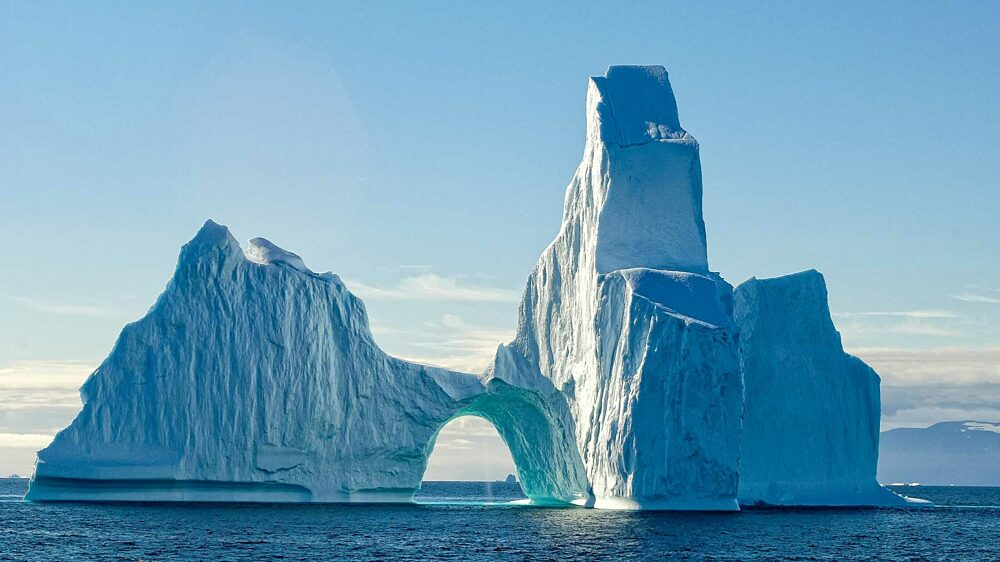 Large iceberg with archway