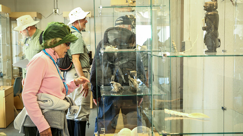 Shoppers browse carvings in a kimmirut shop
