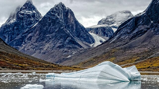 Icebergs and mountains of south Greenland coast