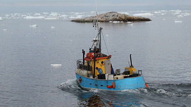 Ilulissat Greenland blue yellow red fishing boat