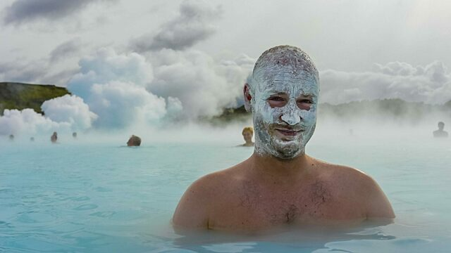 Man in Icelands Blue Lagoon hot spring