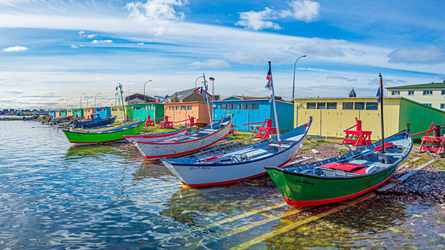Colourful boats and wooden shacks Saint Pierre