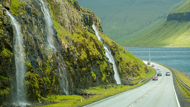 Curving road and waterfalls Faroe Islands