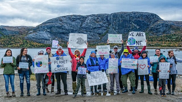 Guests staff community members hold climate march nain