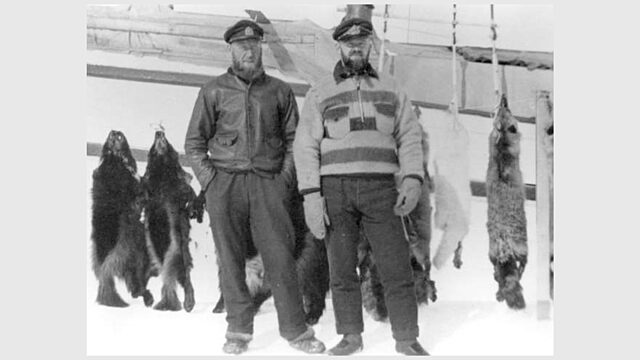 Henry larsen and myles f foster standing in front of the st roch at kogluktualuk tree river nunavut