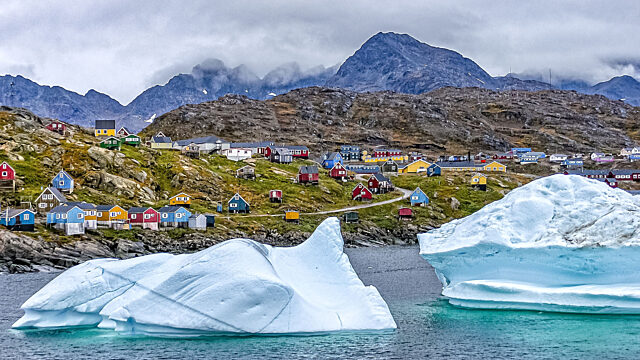 Icebergs in front of houses Tasiilaq Sermersooq Greenland